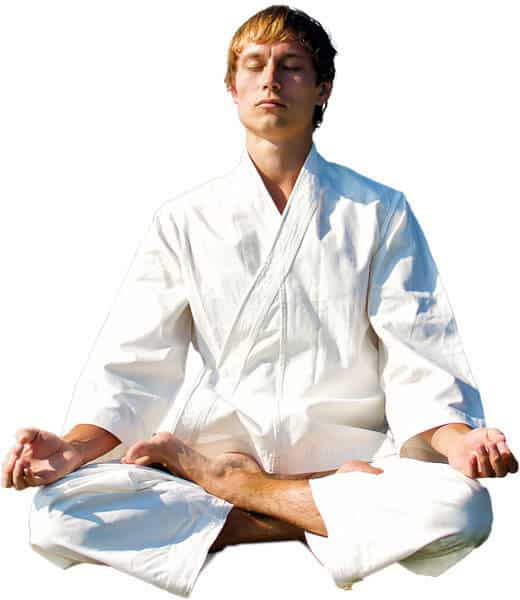 Martial Arts Lessons for Adults in _Naugatuck_ CT - Young Man Thinking and Meditating in White