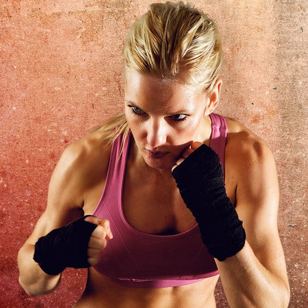Mixed Martial Arts Lessons for Adults in _Naugatuck_ CT - Lady Kickboxing Focused Background