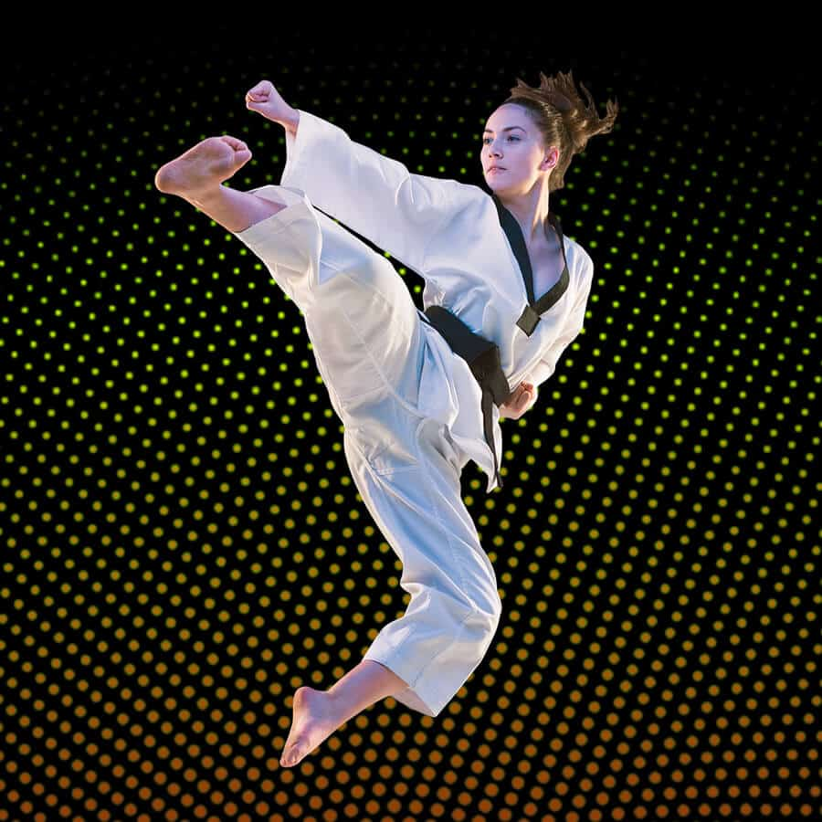 Martial Arts Lessons for Adults in _Naugatuck_ CT - Girl Black Belt Jumping High Kick