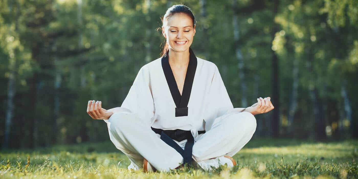 Martial Arts Lessons for Adults in _Naugatuck_ CT - Happy Woman Meditated Sitting Background