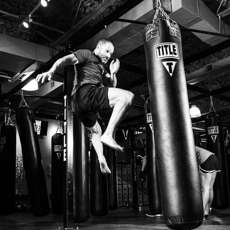 Mixed Martial Arts Lessons for Adults in _Naugatuck_ CT - Flying Knee Black and White MMA